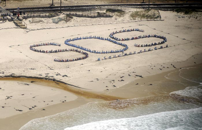 SOS formation, Clovelly Beach by AfriOceans Warriors.  Photo by Michael Walker
